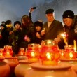 Stock Video: Candle heap, people with candles during Starvation (Holodomor) marks in Kiev, Ukraine.