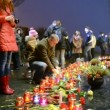 Stock Video: Candle heap, people with candles near Starvation (Holodomor) monument.