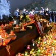 Stock Video: Mwith candle near Starvation (Holodomor) monument in Kiev, Ukraine.