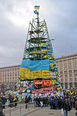 Tree construction from flags with slogans on Euro maidan in Kiev, Ukraine. — Stock Photo