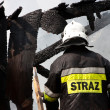 Fire in small village in Poland, rescue action - Stock Photo