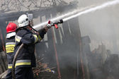 Fire in small village in Poland, rescue action — Foto Stock