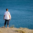 Young boy standing on a cliff — Stock Photo