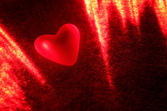 Heart in the light of the laser — Stock Photo