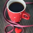Cup of coffee and heart — Stock Photo