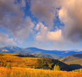 Cloudy sky over the mountains — Stock Photo