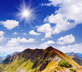 Sunny day in the mountains — Stock Photo