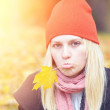 Girl with autumn leaf — Stock Photo