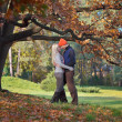 Stock Photo: Happy couple under the tree
