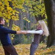 Couple in autumn park — Stock Photo #30877859