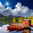 Red boat in a mountain lake — Stok Fotoğraf #30877883