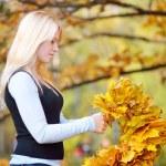 Girl with autumn wreath — Stock Photo