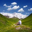 Tourist in the mountains of the Caucasus — Stock Photo #32762459