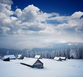 Wooden hut in the mountains — Stock Photo