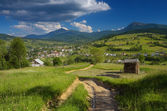Road in the mountain village — Stock Photo
