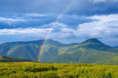 Rainbow in the mountains  — Stock Photo