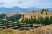 Fence in a mountain village — Stock Photo