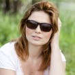 Blond girl in sunglasses at the summer park. — Stock Photo #10449341