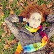 Portrait of red-haired girl in the autumn park. — Stock Photo #12430454