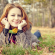 Portrait of red-haired girl in the autumn park. — Stock Photo #12430462