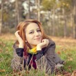 Portrait of red-haired girl in the autumn park. — Stock Photo #12430471