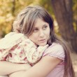 Sad little girl and mother in park — Stock Photo #12430476