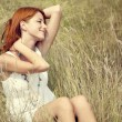 Beautiful red-haired girl at grass — 图库照片