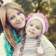 Mother and daughter at the park. — Stock Photo