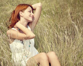 Beautiful red-haired girl at grass — Stok fotoğraf