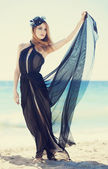 Fashion redhead girl in dress at the beach. — Stock Photo