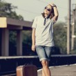 Hipster girl at railways platform. — Stock Photo