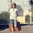 Hipster girl at railways platform. — Stockfoto