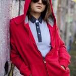 Teen girl in sunglasses near graffiti wall. — Stock Photo #13526497