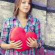 Teen girl with heart at outdoor. - Stock Photo