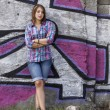 Style teen girl standing near graffiti wall. — Stock Photo #13526518