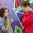 Conflict teens near graffiti wall. — Stockfoto