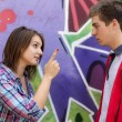 Conflict teens near graffiti wall. — Stock Photo #13526521