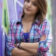 Style teen girl standing near graffiti wall. — Foto Stock