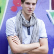 Style teen standing near graffiti wall. - Stock Photo