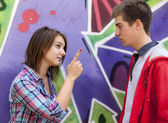 Conflict teens near graffiti wall. — Stock Photo