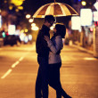 Couple walking at alley in night lights. Photo in vintage multic — Stock Photo