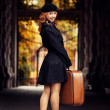 Style redhead girl with bag at the autumn street. — Stock Photo