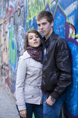 Young couple near graffiti background. — Stock fotografie
