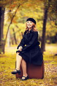 Style redhead girl with bag at the autumn park. — Stock Photo