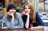 Two girlfriends in the cafe. — Stock Photo