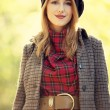 Style redhead girl at beautiful autumn alley. - Stock Photo