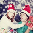 Girl strangling her boyfriend for a christmas gift. — Stock Photo #14374795