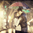 Couple at alley in night lights. Photo in vintage multicolor sty - Stock Photo