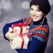 Stock Photo: Beautiful girl with gifts.