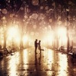 Couple walking at alley in night lights. Photo in vintage style. — Stock Photo #15785785